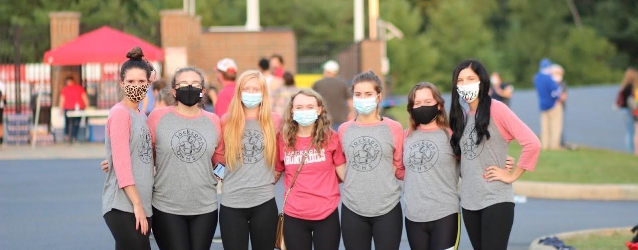 Jackson High School honor society girls at a football game