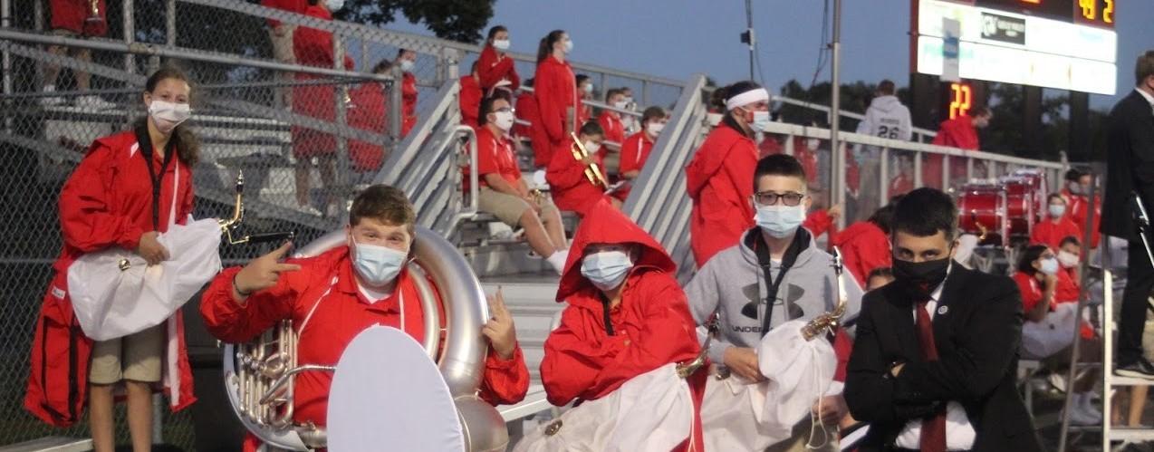 Band members posing at a football game